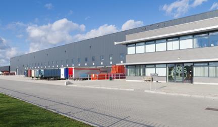 Photo of large warehouse with docks.